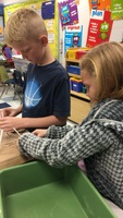 Timothy S. and Kenzie R. use teamwork to complete their bridge