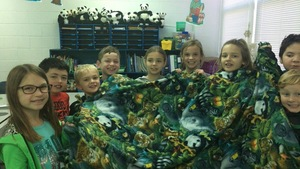 R. Watson's Class making blankets to donate for the Foster Care Christmas Party